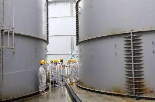 Nuclear watchdog members inspect contaminated water tanks at Fukushima nuclear power plant, August 23, 2013