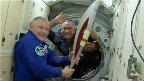 Olympic torch blasts into space for 1st spacewalk