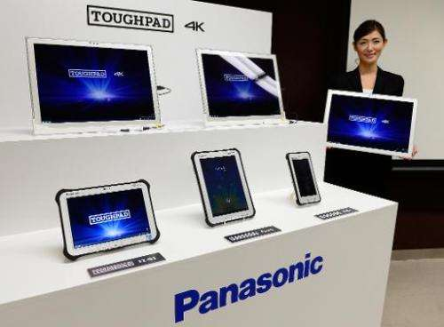 Panasonic introduces its new tablet personal computer 'Toughpad 4K UT-MB5' at a press conference in Tokyo on September 6, 2013
