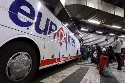 Passengers queue in an international bus terminal in Bagnolet, outside Paris, on June 4, 2012