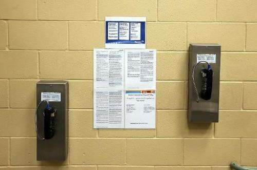 Pay phones for inmates are seen on a wall at the Fremont Police Detention Facility on August 1, 2013 in Fremont, California