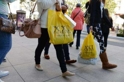People look for sales the old-fashioned way—at a shopping mall—in Glendale, California, on December 26, 2012