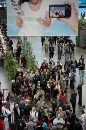 People queue at the south entrance for the IFA trade fair in Berlin on August 31, 2012