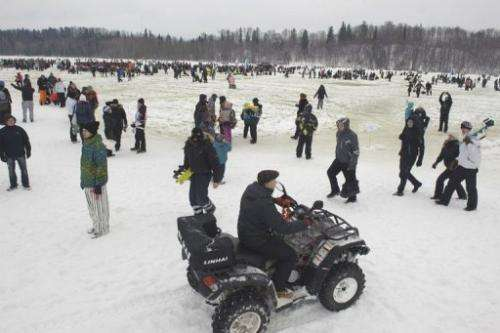 People take part in a fishing event on the frozen lake Viljandi in Viljandi, Estonia on February 16, 2013