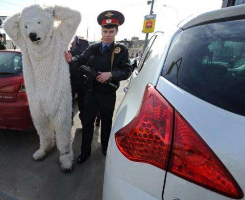 Police officers detain Greenpeace activists wearing polar bear costumes in Moscow, on April 25, 2013