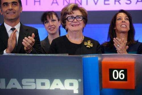 President of FGI Margaret Hayes rings the closing bell at NASDAQ MarketSite on October 21, 2013 in New York City