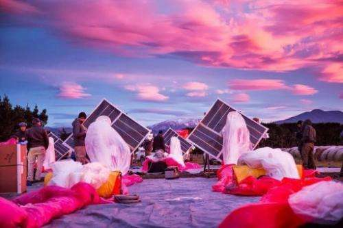 Project Loon solar panels (C) and a high altitude ballon before its take off in Tekapo, New Zealand on June 16, 2013
