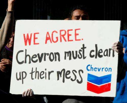 Protesters gather in the Federal Plaza in Manhatan to protest against Chevron Corporation October 15, 2013 in New York