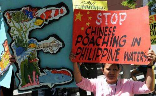 Protesters rally in front of the Chinese consular office in Manila on April 11, 2013