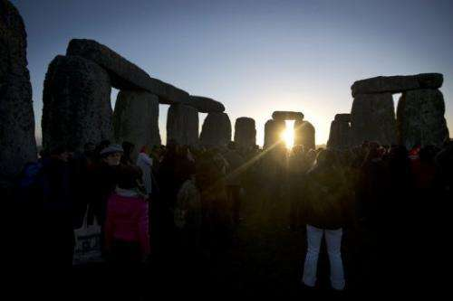 Revellers celebrate the pagan festival of 'Winter Solstice' at Stonehenge in Wiltshire, England on December 21, 2012