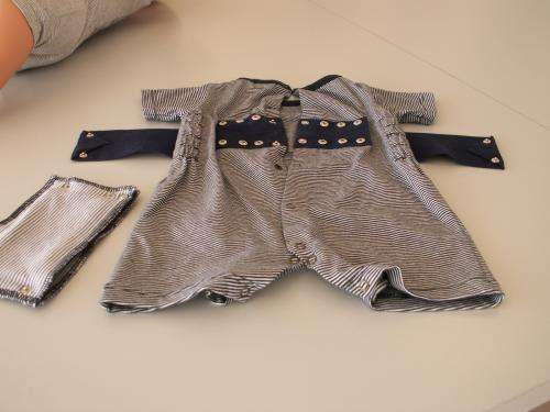 Romper suit to protect against sudden infant death