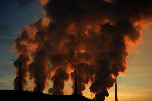Smoke billows from the cooling towers of a coal-fired power plant in Gelsenkirchen, western Germany, on January 16, 2012