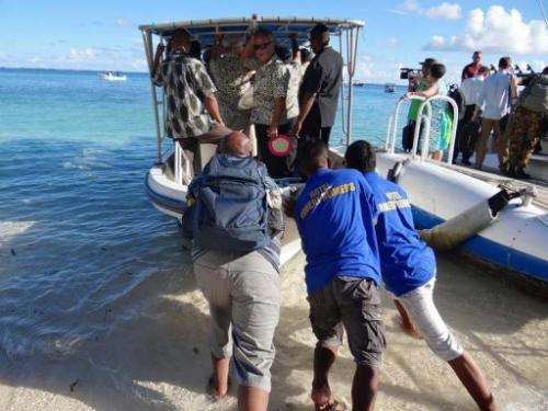 Staff push a boat used to transport Pacific Islands Forum leaders from Eneko Island on September 5, 2013