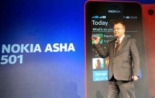 Stephen Elop holds a Nokia Asha 501 mobile phone as he addresses an unveiling ceremony in New Delhi on May 9, 2013
