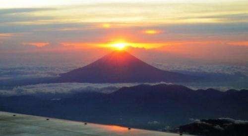 Sun rises behind Mount Fuji early on January 1, 2012