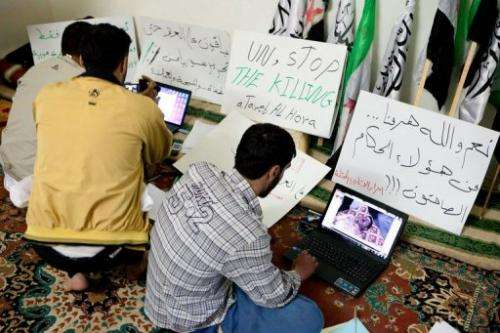 Syrian activists upload pictures and news of unrest to opposition websites in the town of Atareb on April 26, 2012