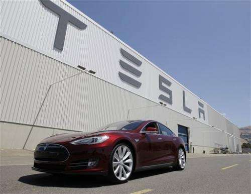 Tesla CEO says fire caused by impaled battery
