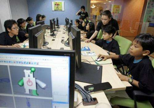 Thai children take part in a training session of a computer animation program at a school in Bangkok, May 6, 2006