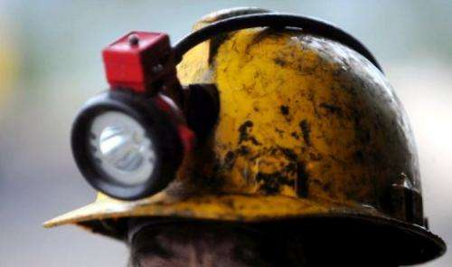The helmet of a miner is seen during search operations of the explosion in a coal mine in Colombia on June 18, 2010
