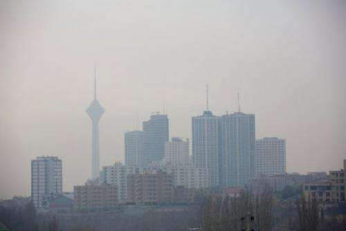 The Milad telecommunication tower and buildings in Tehran engulfed by smog on December 5, 2012