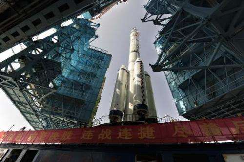 The Shenzhou X spacecraft carried by a Long March-2F carrier rocket is installed at the launch pad in Jiuquan, Northwest China's