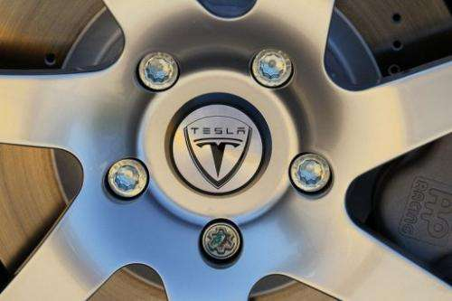 The Tesla Motors logo is seen on the wheel of a car at Tesla Motors headquarters, May 20, 2010 in Palo Alto, California