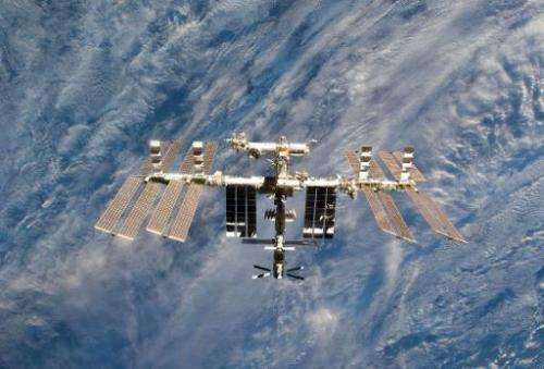 This March 7, 2011 NASA handout image shows the International Space Station in an image photographed by an STS-133 crew member o