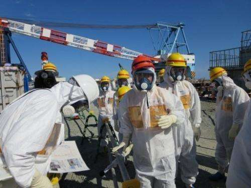 Toshimitsu Motegi, the Japanese Economy, Trade and Industry Minister, inspects the Fukushima plant on August 26, 2013