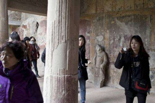 Tourists visit the restored Thermae Stabianae baths in Pompeii, Italy, on March 8, 2012
