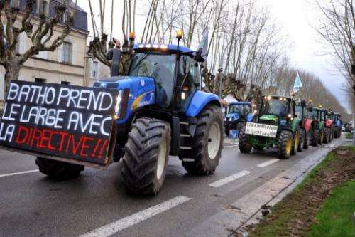 Tractors block a street during a demonstration against governmental regulations on nitrate in France, January 16, 2013