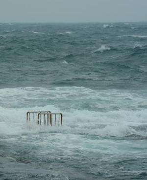 Waves cover the ladder of a swimming pool at Hoping island, in Keelung, northern Taiwan as Typhoon Fitow approached on October 5