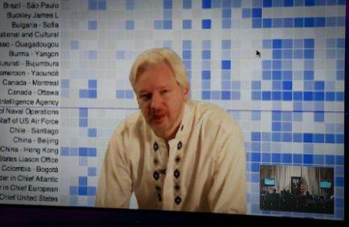WikiLeaks founder Julian Assange speaks during a teleconference between London and Washington on April 8, 2013