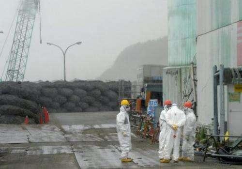 Workers take a break at Japan's Fukushima Dai-ichi nuclear plant in Okuma town in Fukushima prefecture on June 12, 2013