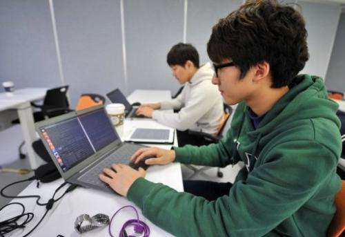 Young computer experts are pictured at the Korea Information Technology Research Institute in Seoul on February 14, 2013