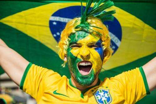 A Brazil fan cheers for his team outside the Mineirao stadium in Belo Horizonte, southern Brazil on June 28, 2014 before the Wor
