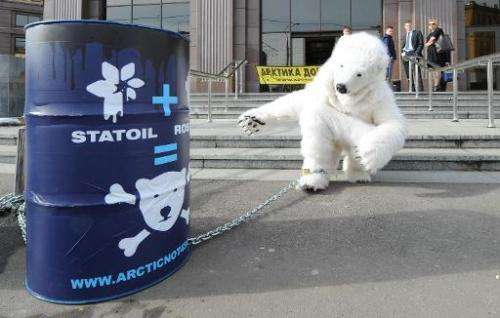 A Greenpeace activist in a polar bear costume protests outside Norwegian company Statoil's office in Moscow on April 25, 2013 ag