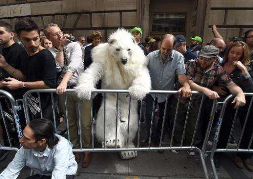 """A man dressed as a polar bear climbs a barricade as protestors take part in the """"Flood Wall Street"""" demonstrations on"""