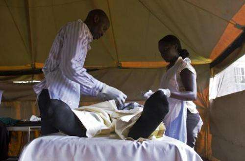 A patient is fitted with a non-surgical circumcision device called Prepex in Mukono on May 12, 2014