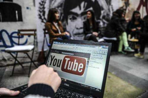 A person looks at YouTube on a laptop in Istanbul on March 27, 2014