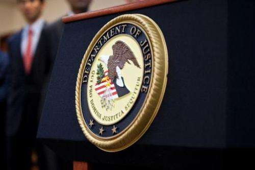 A US Department of Justice seal is displayed on a podium on December 11, 2012 in the Brooklyn borough of New York City