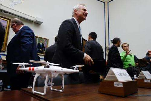 Captain Lee Moak, president of the Air Line Pilots Association, stands behind a DJI Phantom 2 drone after testifying in Washingt