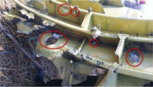 Damage to the cockpit gives a clue to loss of flight MH17