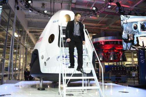 Elon Musk unveiling SpaceX's new seven-seat Dragon V2 spacecraft, in Hawthorne, California, May 29, 2014
