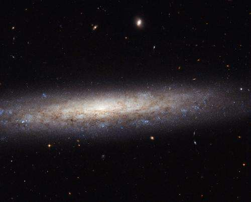 Image: Hubble catches a dusty spiral in Virgo