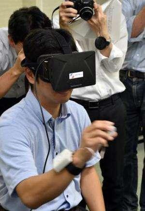 "Japan's high-tech venture Miraisens CEO Natsuo Koda demonstrates ""3D-Haptics technology"", at a press preview in Tsukub"