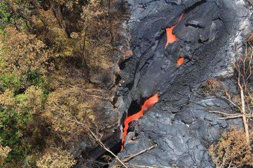 Lava flowing toward homes on Hawaii's Big Island