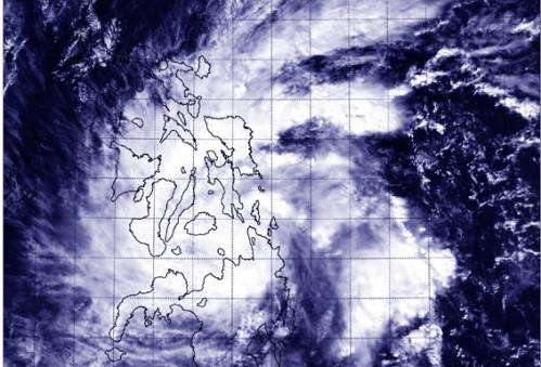 NASA spots Tropical Storm Jangmi moving into Sulu Sea