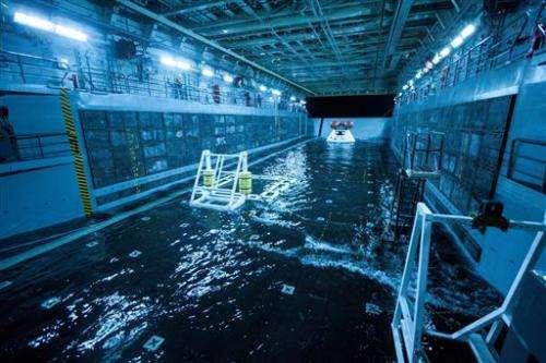NASA suspends Orion space capsule test in ocean