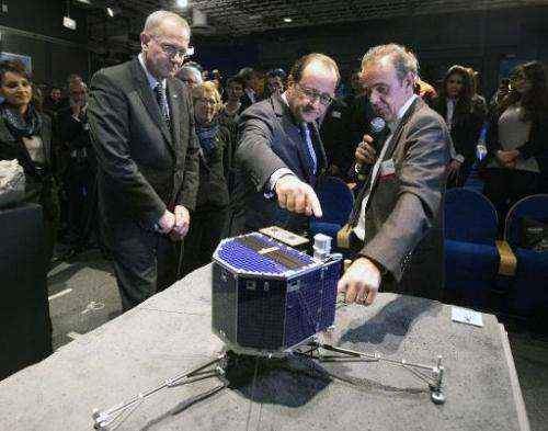 National Centre for Space Studies (CNES) president Jean-Yves Le Gall (L), French President Francois Hollande and French astrophy