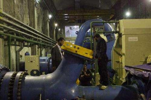 Pakistani Kashmiri technicians work at a hydro project in the mountainous Neelum Valley in Pakistan-administered Kashmir on Nove